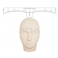 Glue ruler to mark the symmetrical shape of the eyebrows
